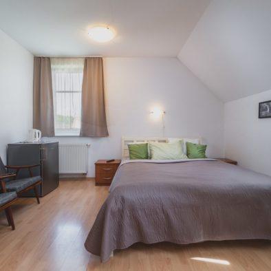 Dvojlôžková izba postel